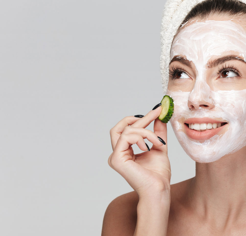 Beauty and personal care routine with a female applying a face mask